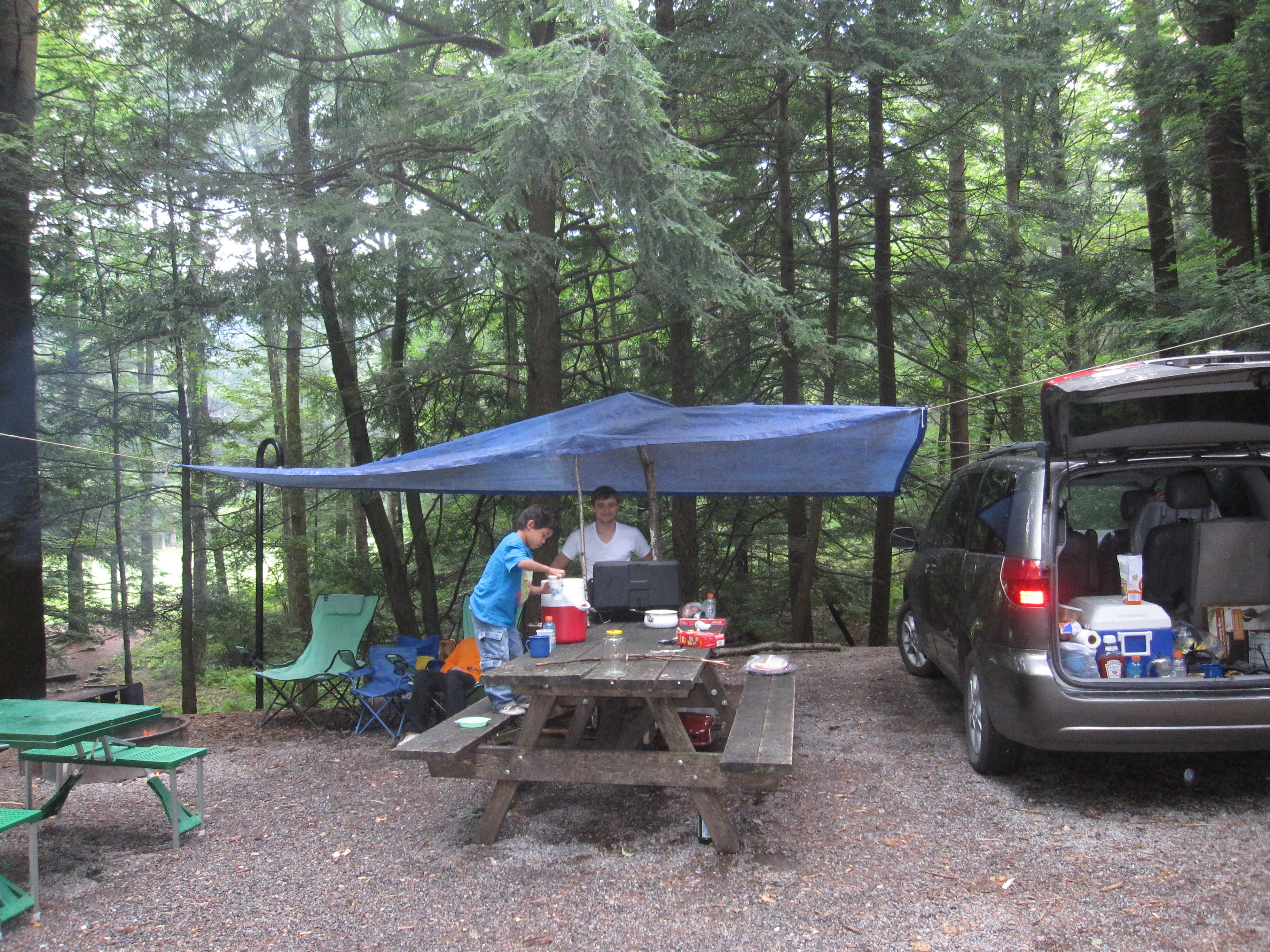 Family Camping In The Woods After Downpour We Went On A Hike Campsite